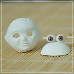 голова куклы - вид спереди